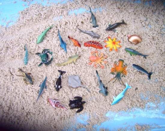 Themen dekoration kleine fische aus kunststoff for Kleine fische